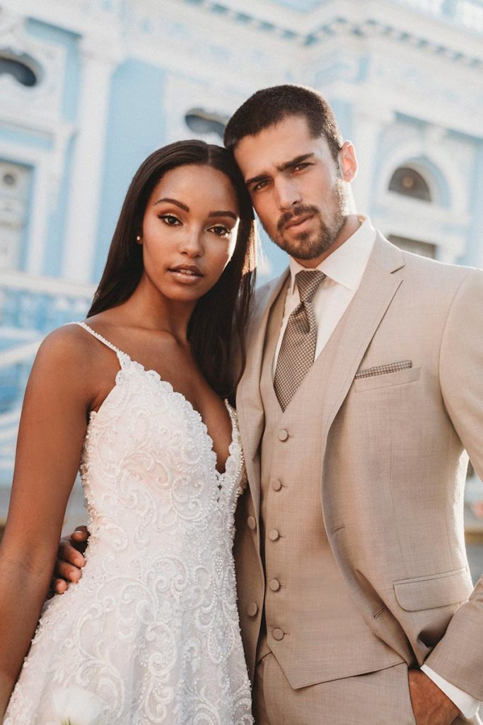 10 Tips For Wearing A Tuxedo. Bridal couple with groom wearing Dapper's tan tuxedo